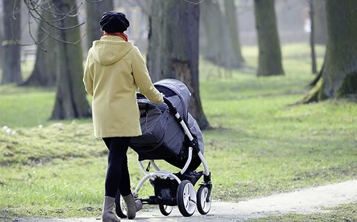 Woman walking with pram