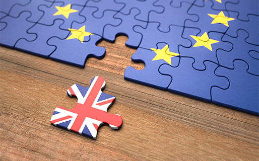 Brexit showed by a UK puzzle piece leaving a EU puzzle