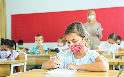 Child at school with mask on