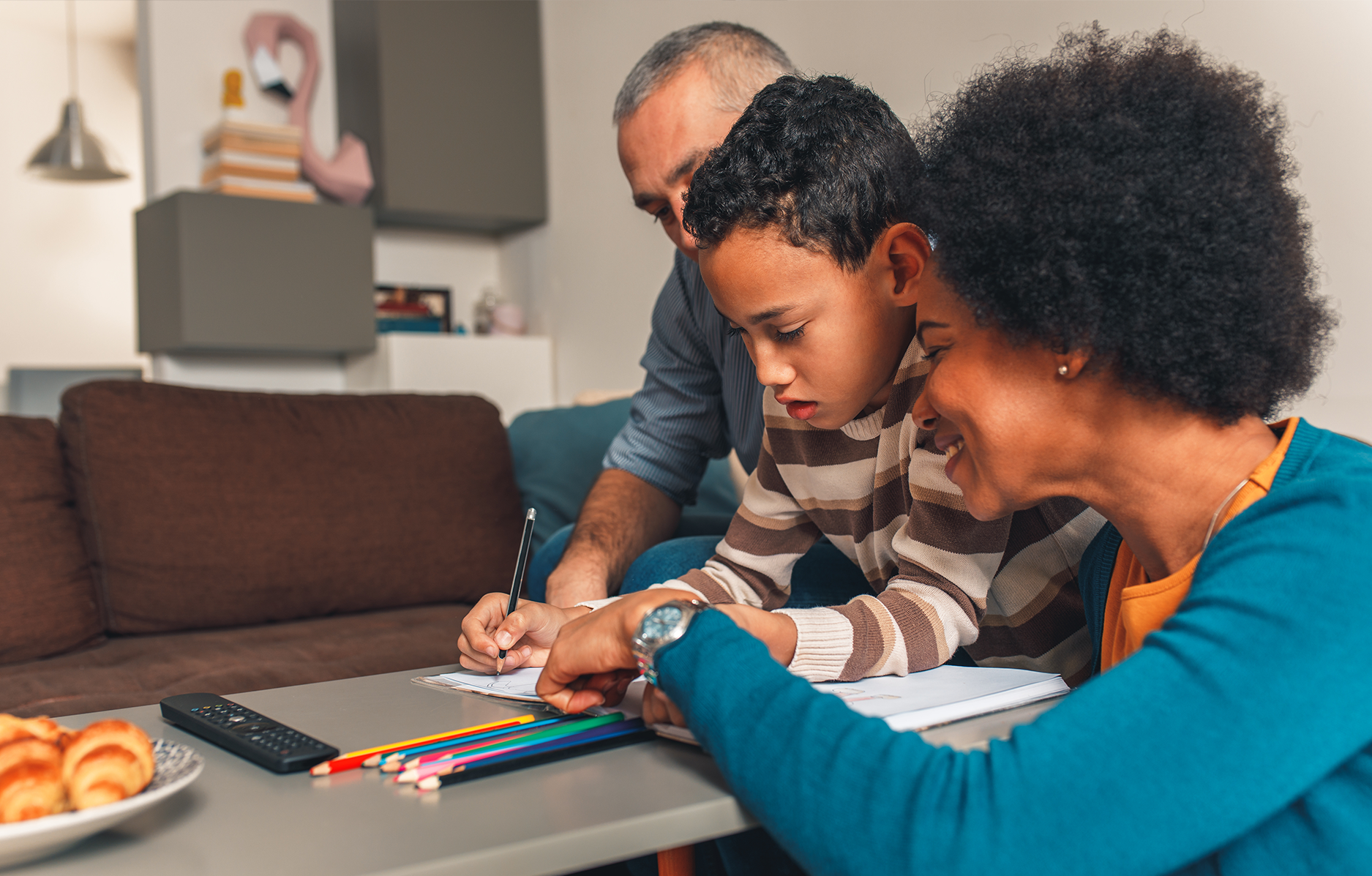 Family helping child with home work
