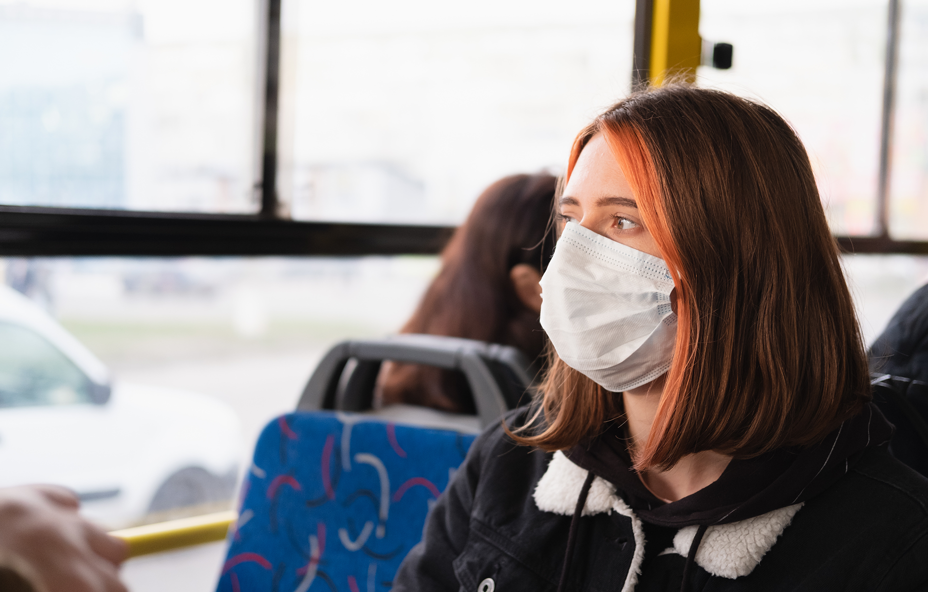 Person commuting with face mask