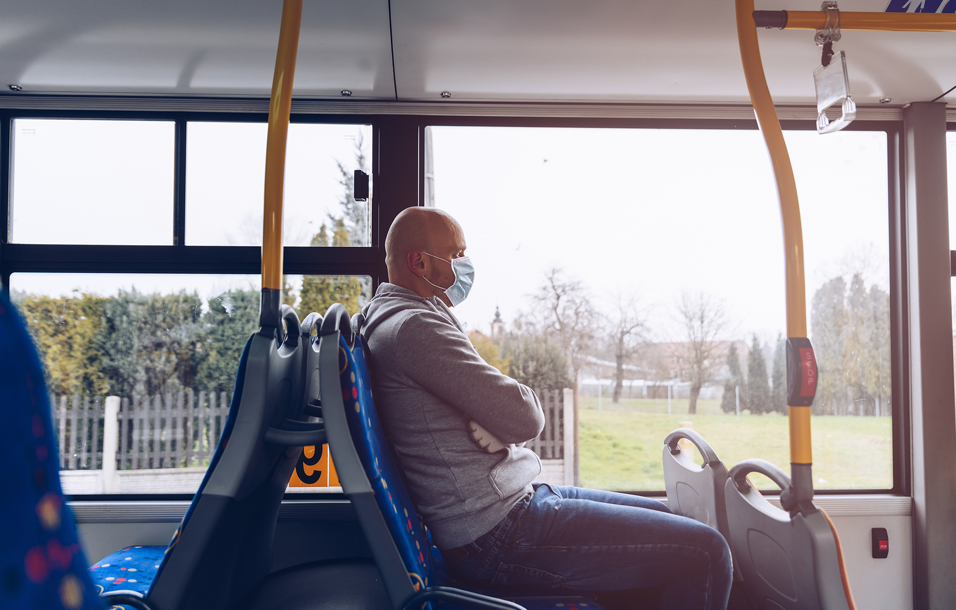 Man in mask on bus