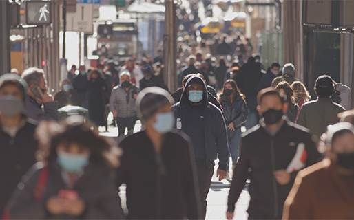 Crowd of people wearing COVID-19 masks