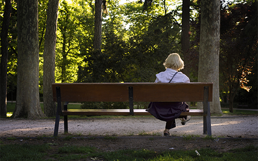 Older woman sitting in a park
